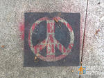 SF Mission Peace sign cover up
